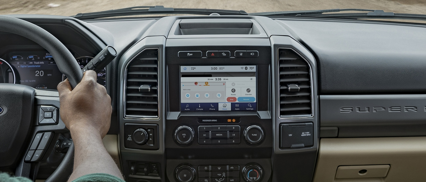 2020 Ford Super Duty interior with person driving