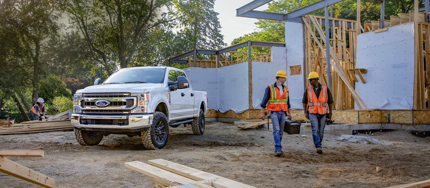 2020 Ford Super Duty Pickup on construction site with 2 workers