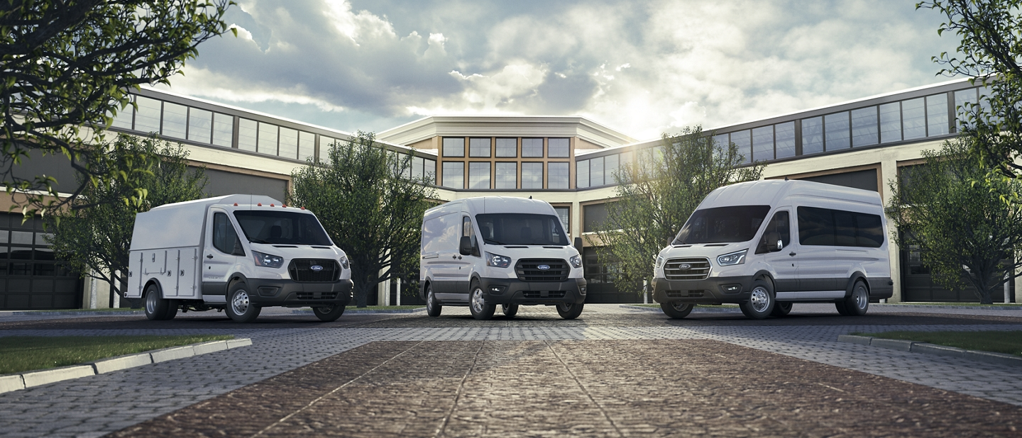 A 2020 Ford Transit parked infront of a large building