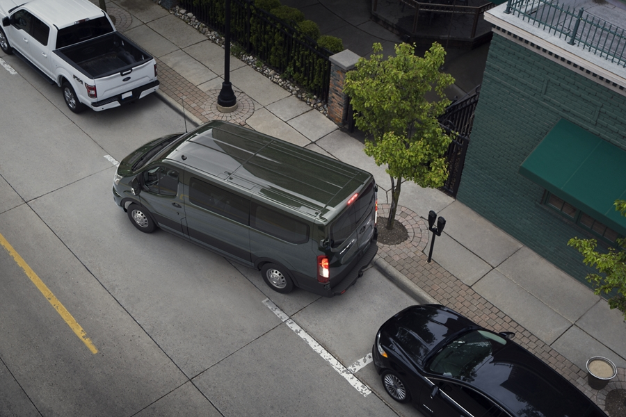 A 2020 Ford Transit being parallel parked