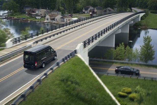 A 2020 Ford Transit being driven over a bridge
