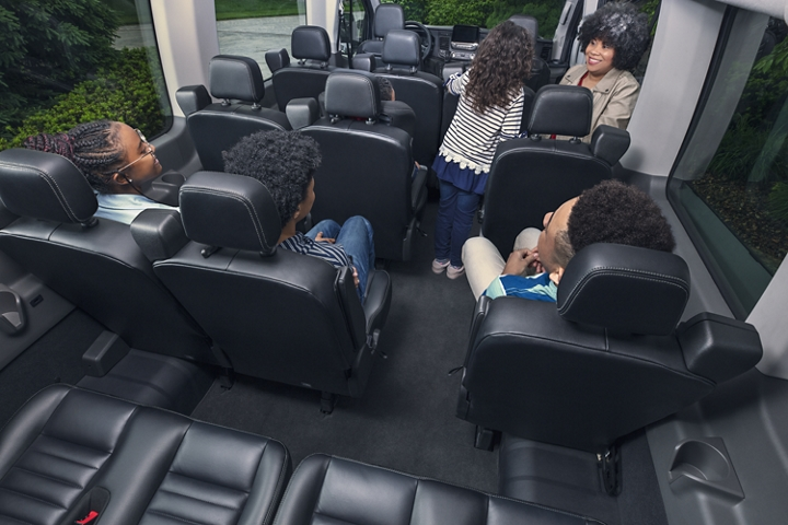 The interior of a 2020 Transit Passenger Van with a family getting seated