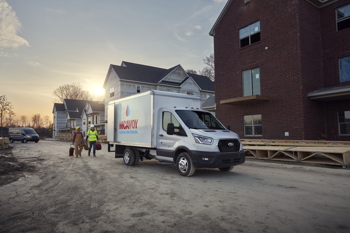 2020 Ford Transit Cutaway box truck upfit on a new build site with workers