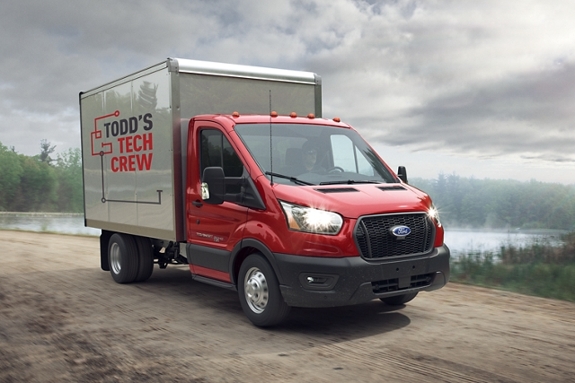 2020 Ford Transit Cutaway on a dirt road near a lake