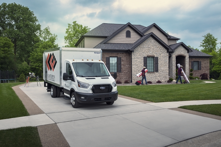 2020 Ford Transit Cutaway box truck upfit in front of suburban home with flooring contractors
