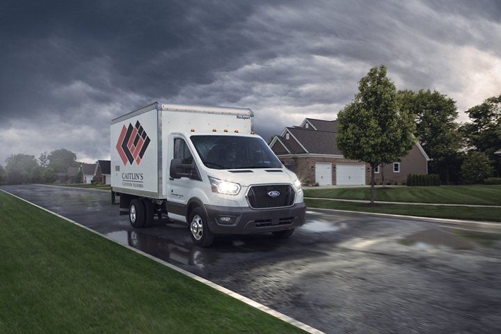 2020 Ford Transit cutaway with box truck upfit driving on a stormy day