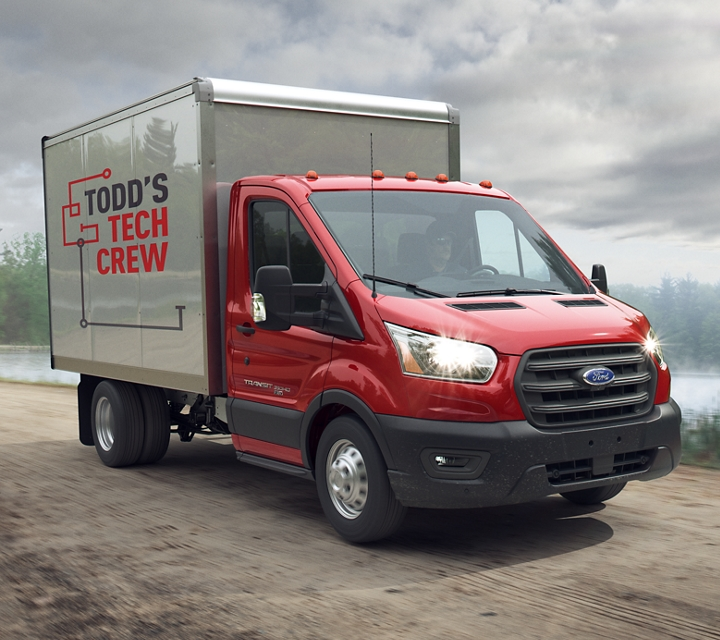 2020 Ford Transit Cutaway box truck upfit driving on an unpaved road