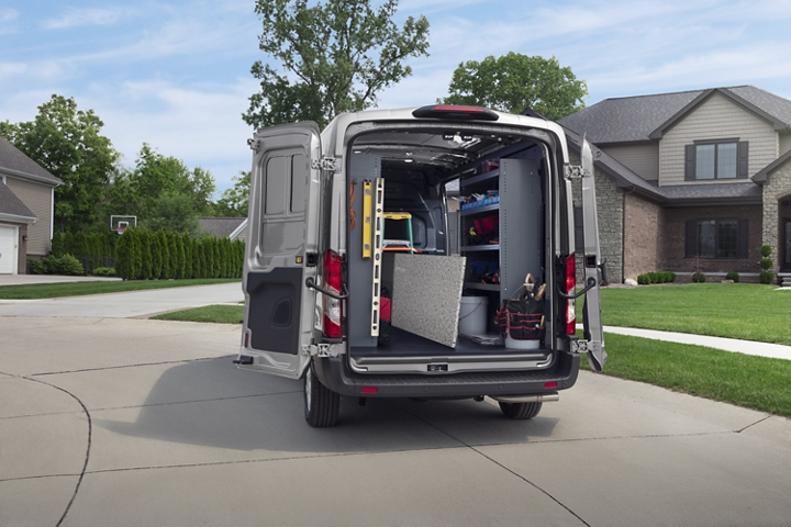 A 2020 Ford Transit seen from behind with open cargo doors