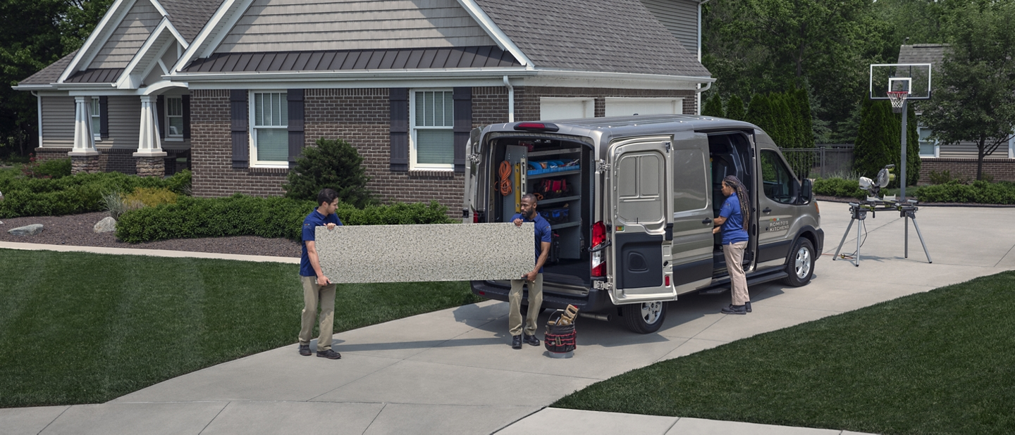 A group of people unloading a 2020 Ford Transit