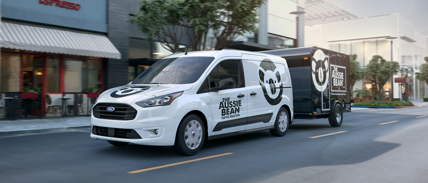 2020 Ford Transit Connect Cargo Van in the city towing a trailer