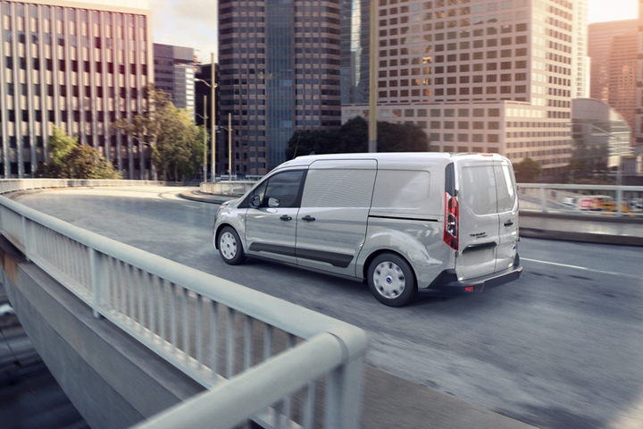 Capable and hard working 2020 Ford Transit Connect X L T Cargo Van in Silver is being driven on a road