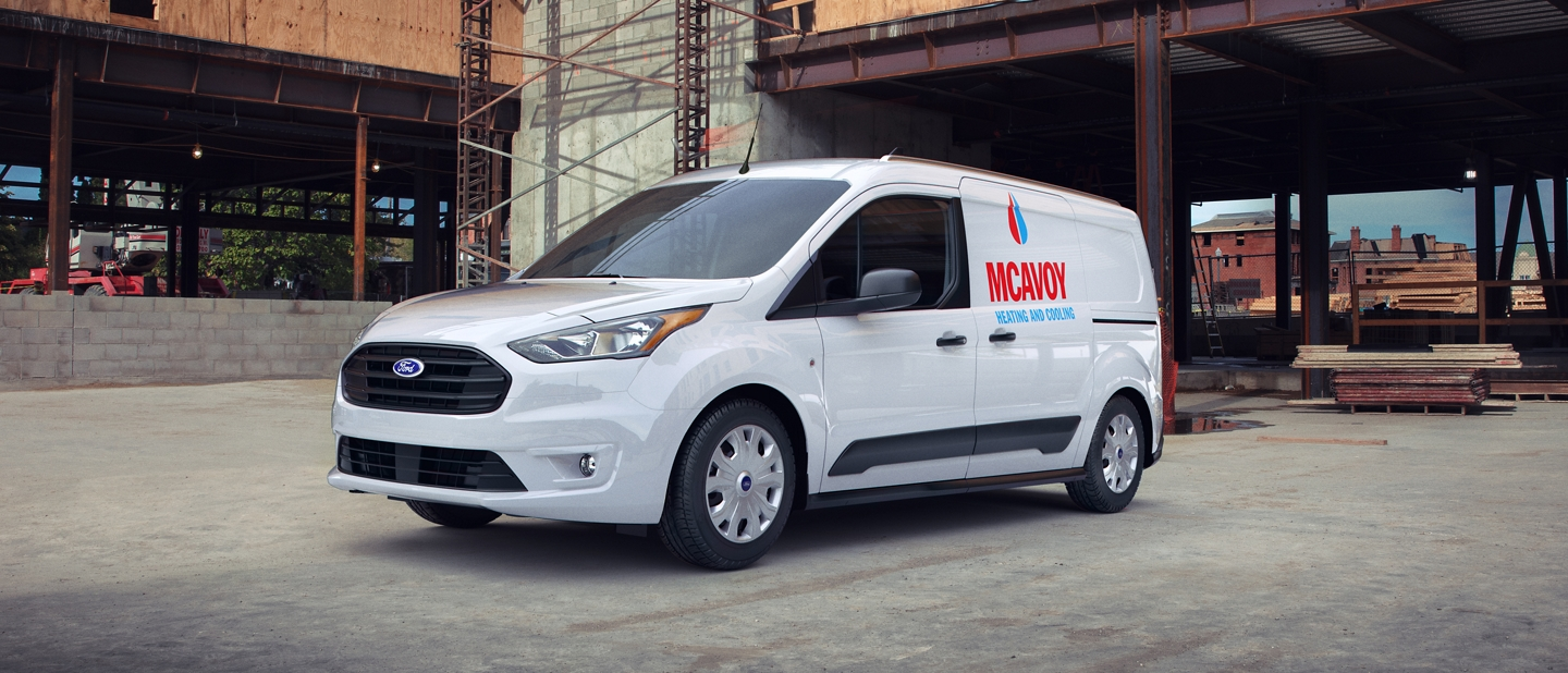 2020 Frozen White Ford Transit Connect Cargo Van shown at a job site