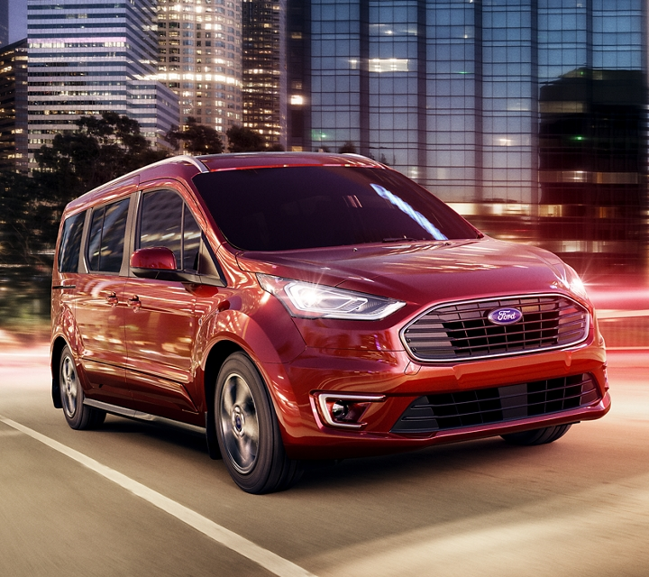 2020 Kapoor Red Transit Connect Passenger Wagon looking good in the city