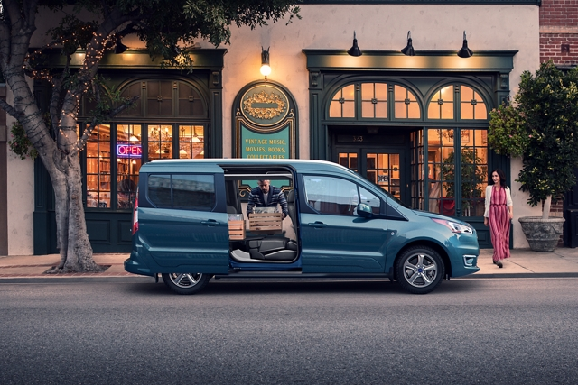 2020 Ford Transit Connect Passenger Wagon parked on city street during the daytime with opened dual sliding side doors