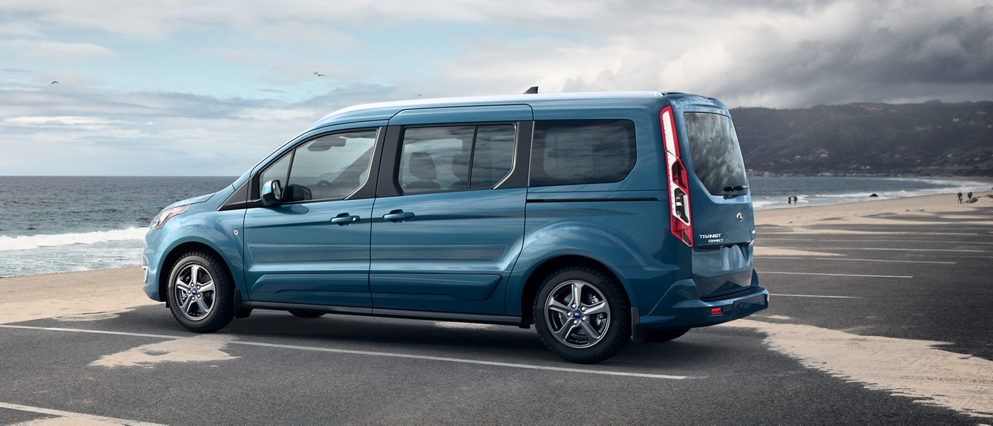 2020 Ford Transit Connect Passenger Wagon in Blue parked by a beach in the daytime