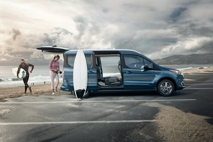 2020 Ford Transit Connect Passenger Wagon on the beach with open dual sliding side doors and rear liftgate