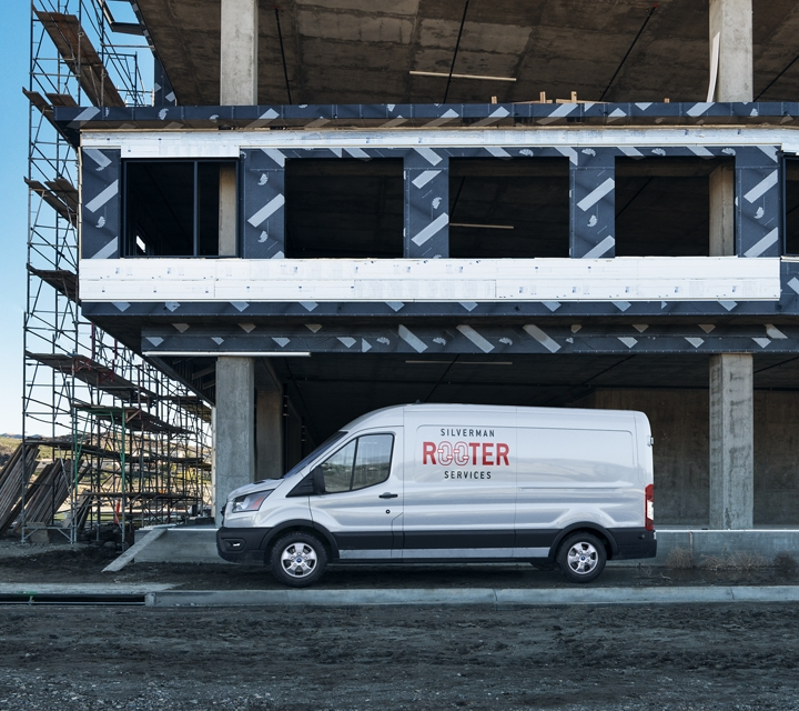 Transit cargo van on site of a new home being built