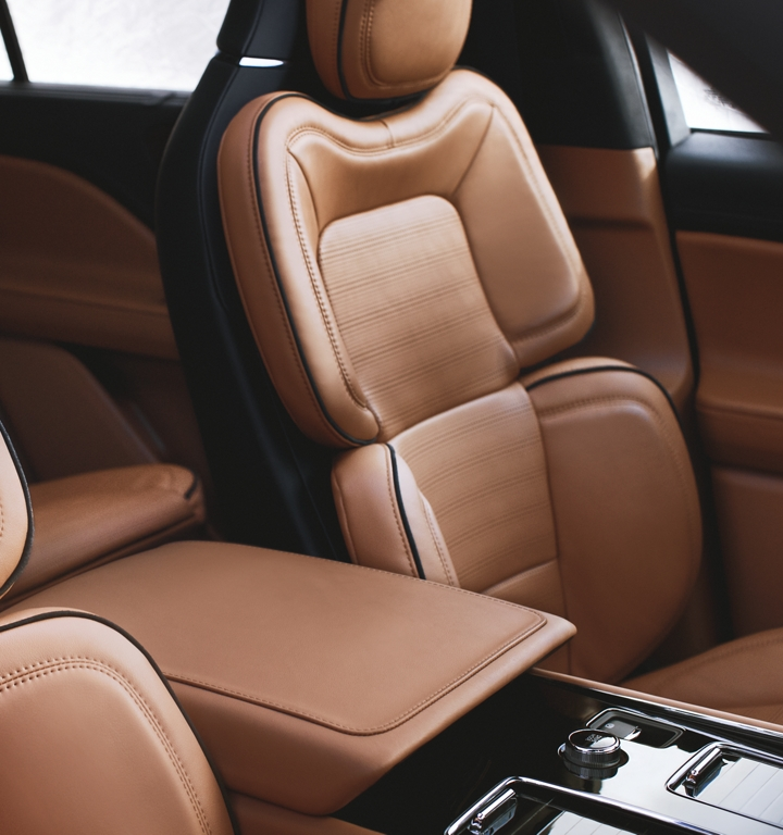 The front row perfect position seats are shown in a rich and warm luggage tan inspired interior color