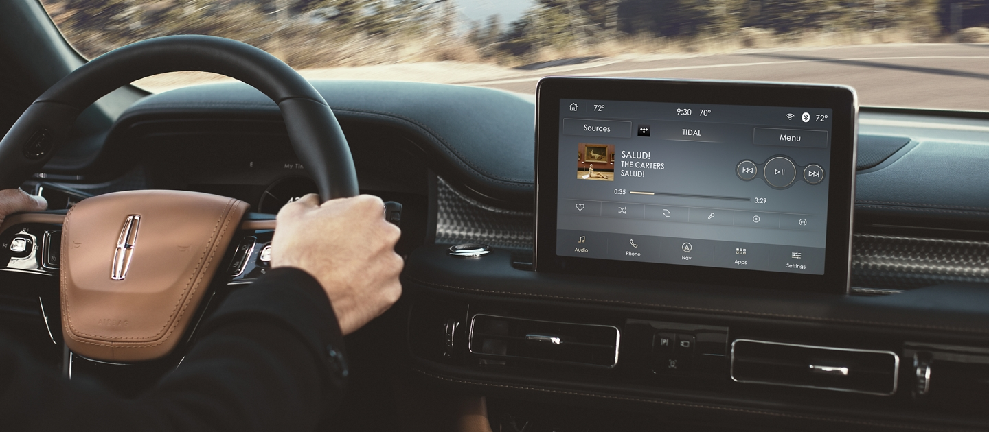 Tidal a streaming music and entertainment service is shown in the center screen of a Lincoln Aviator