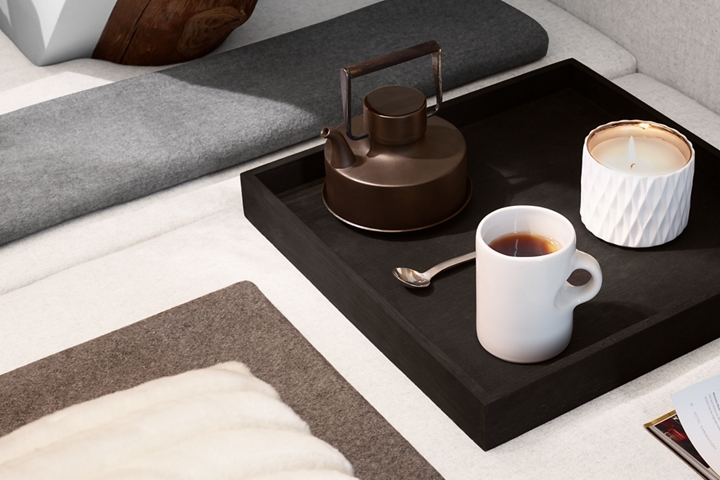 A serving tray with a kettle cup and glowing candle help demonstrate the inspiration for the Chalet theme