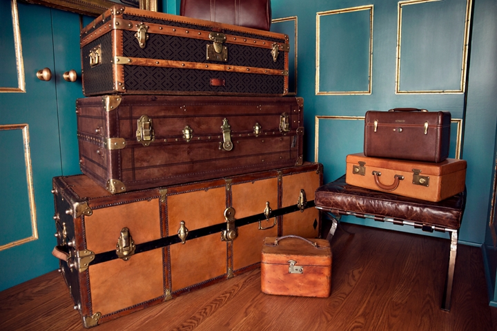 Stacked luggage is shown in the lobby of a guest retreat to demonstrate the inspiration for the Destination theme