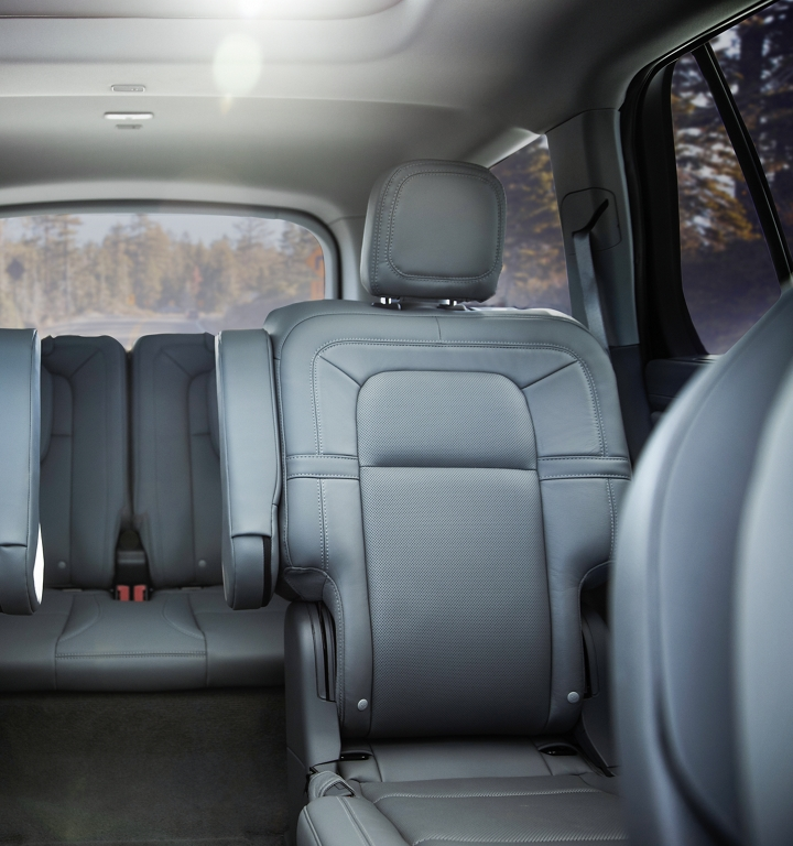 The second and third rows of a Lincoln Aviator are shown with the second row with the captains chair configuration