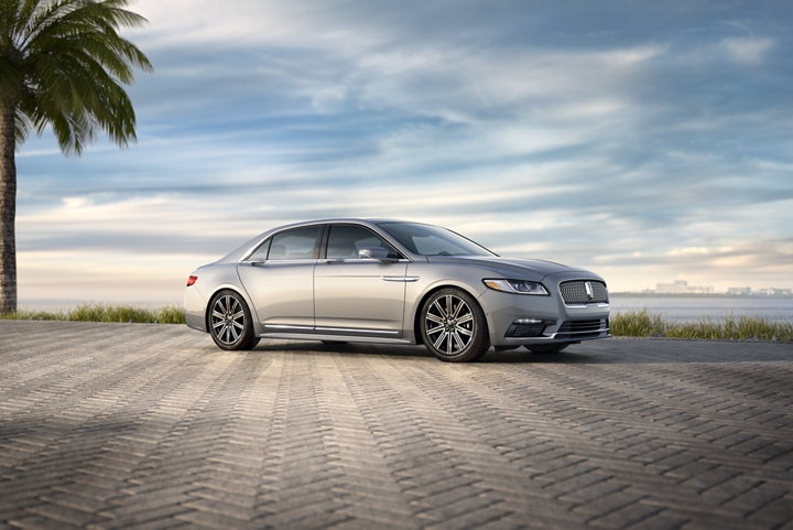 The Lincoln Continental shown in the Ingot Silver exterior color is parked confidently in a seaside marina