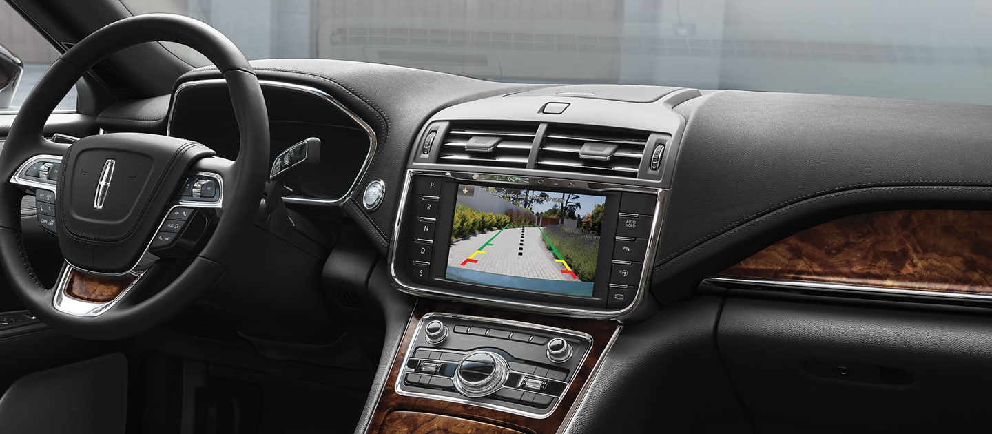 The center screen in the dash of a Continental shows what is behind the vehicle via the rear backup camera