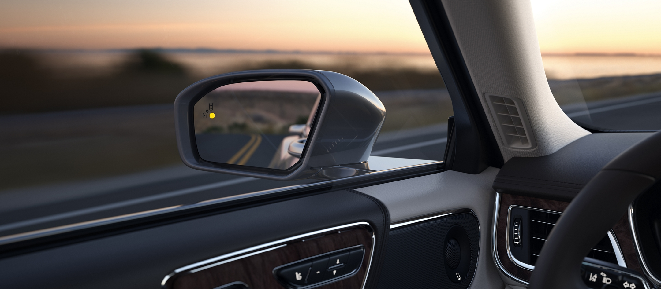 The blind spot detection indicator in the drivers side view mirror is shown indicating that a vehicle is in the blind spot