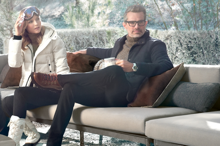 A couple is shown relaxing with warm cups of coffee to represent the inspiration for the Chalet theme