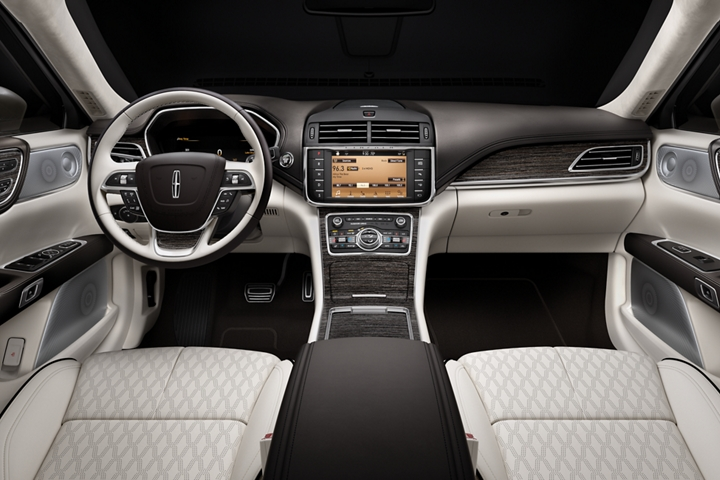 The steering wheel and center console are shown in this image