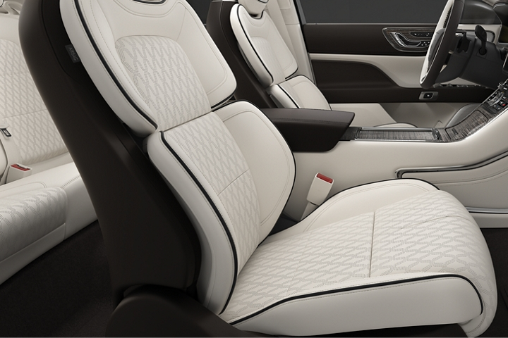 A side view shows the front passenger and drivers seats in the rich white of the Chalet theme