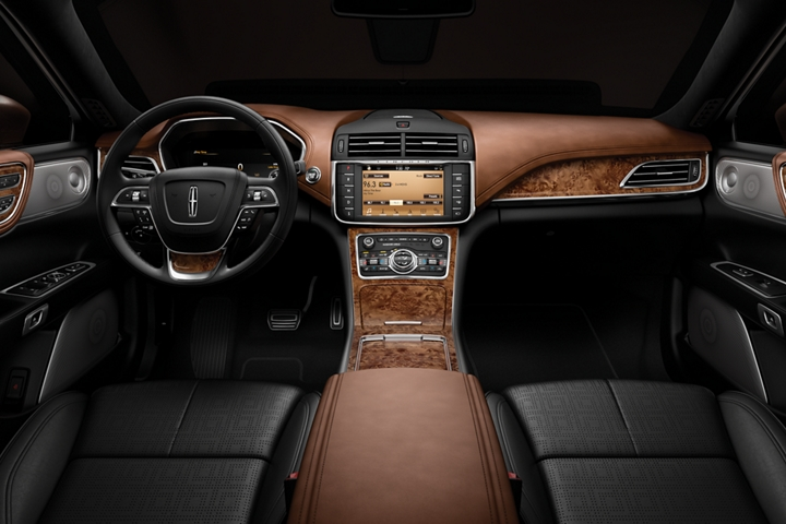 The interior of a Lincoln Black Label Continental in the Thoroughbred theme is shown from a rear seat perspective