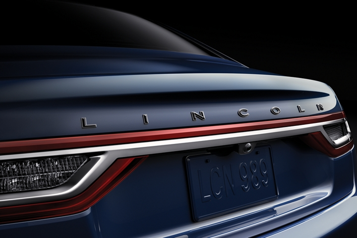 The trunk line of a Continental is shown with the word Lincoln prominently displayed
