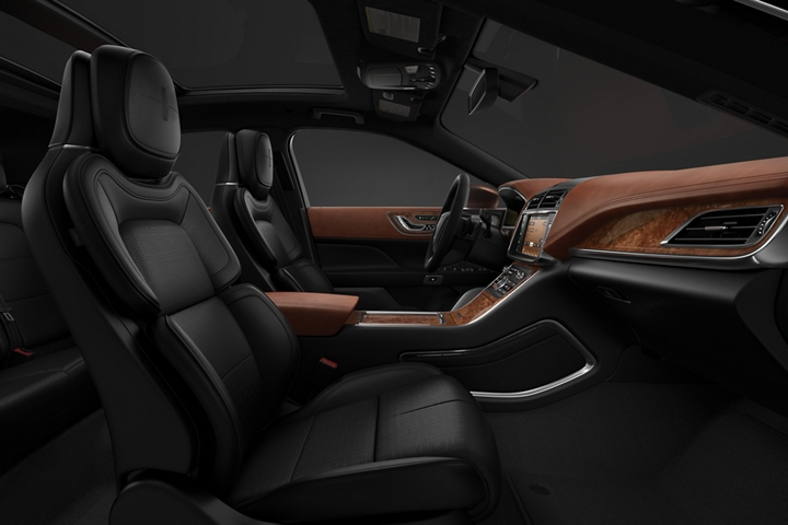 A side view shows the front passenger and drivers seat in the Thoroughbred theme