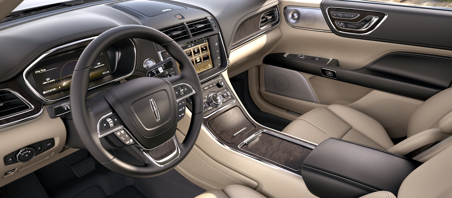 The front seats, seen in the Cappuccino interior color, display craftsmanship and a connected flow.
