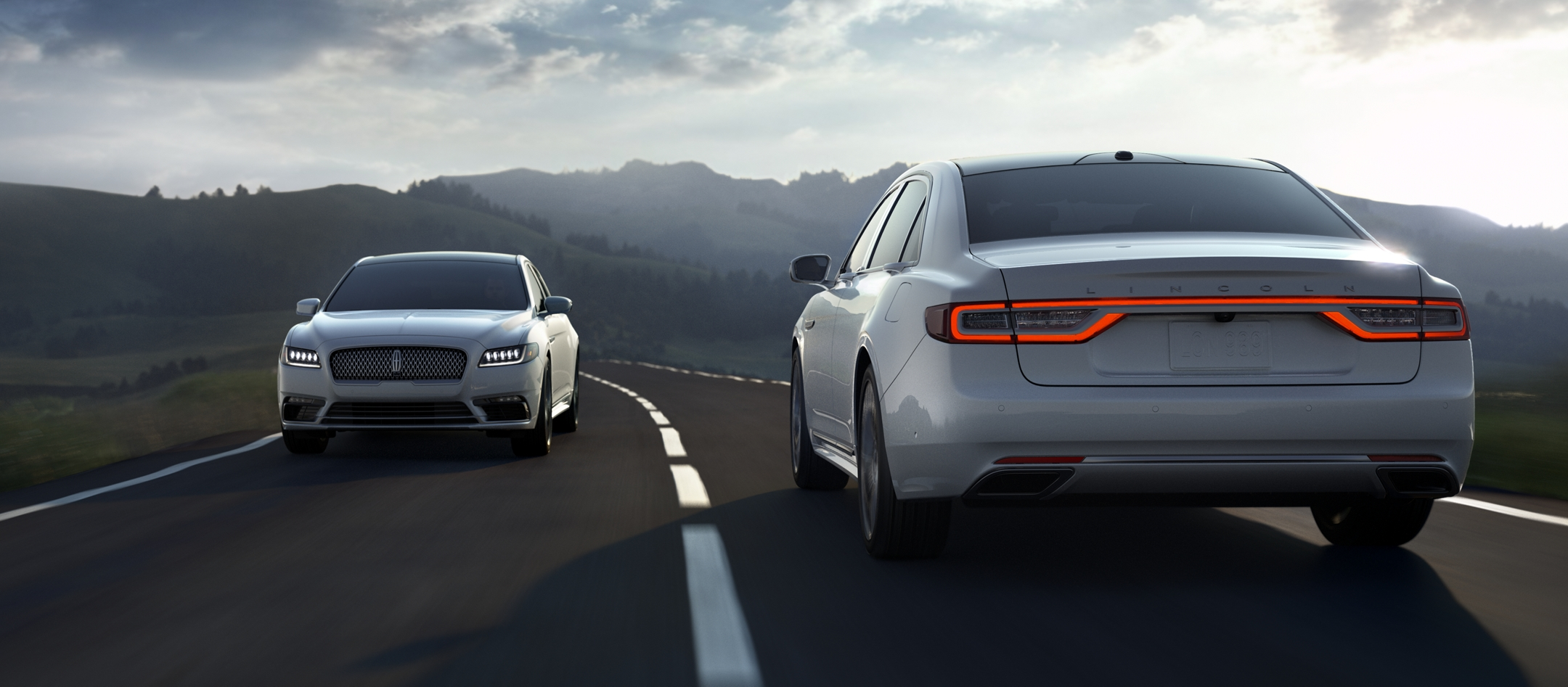 A Lincoln Continental is being driven past another vehicle demonstrate the Lane Keeping System