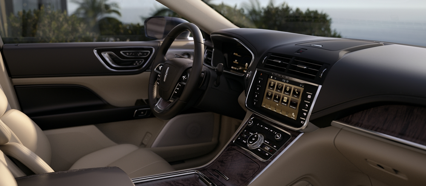 The Lincoln Continental is shown with a cappuccino interior with wood inlays and other touches