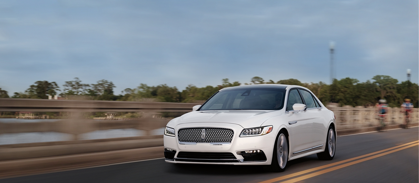 Shown in the White Platinum Metallic Tri-Coat exterior color, the Continental keeps to its lane with assisted steering