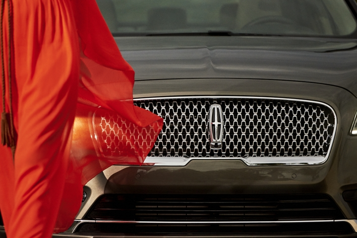 The attractive grille of the 2020 Lincoln Continental is shown with a bold Lincoln logo in the center of a field of repeating logos