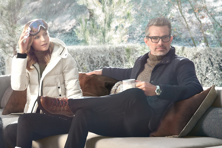 A couple is shown relaxing with warm cup of coffee to represent the inspiration for the Chalet theme