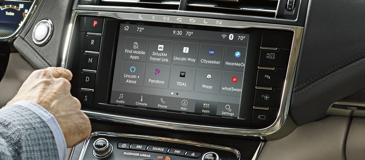 The center touchscreen of a Lincoln Continental displays various apps via the sync 3 app link