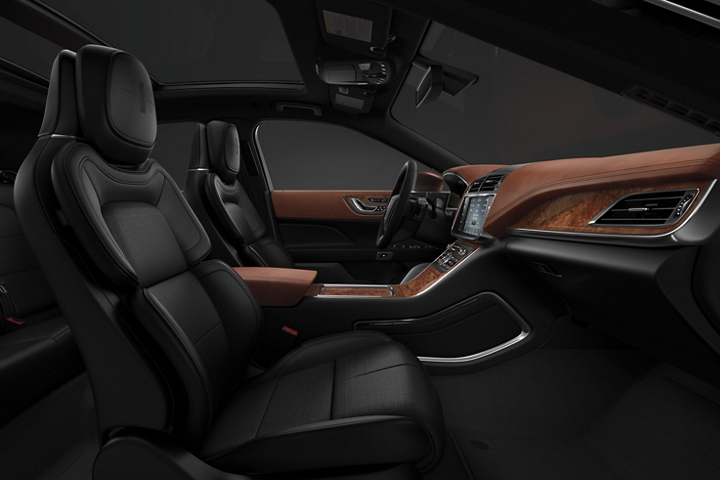 A side view shows the front passenger and drivers seat in the Thoroughbred theme with rich chestnut leather appointments