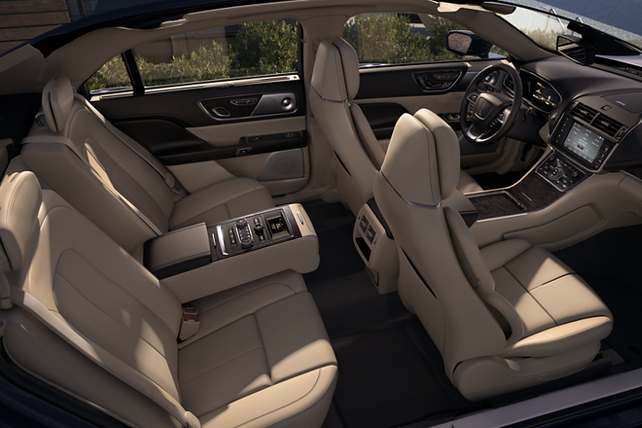 Sunlight pours into the cabin of a Continental giving the available leather trimmed seats an inviting glow
