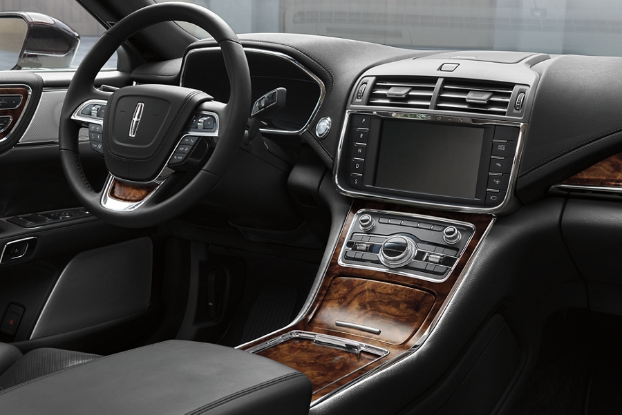 Captivating Brown Swirl Walnut wood details are shown throughout the cabin of a Lincoln Continental