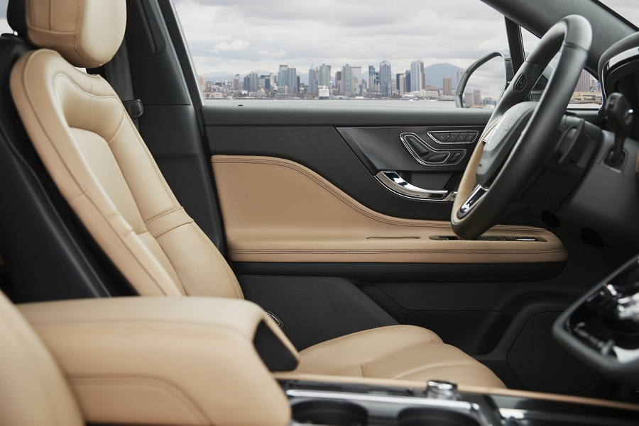 The perfect position front seats in creamy cashew leather show off comfort that hugs your every curve