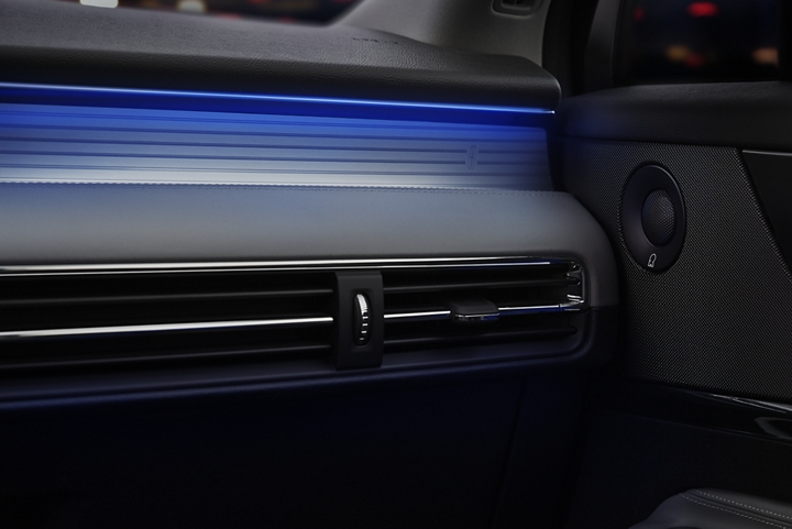 A thin electric blue light illuminates the chrome plate under a black dashboard emitting a cool energy
