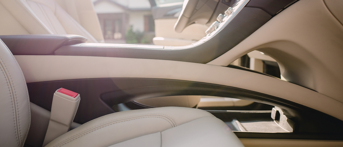 A brightly lit interior image of the 2020 Lincoln M K Z shows the storage capacity of the center console area
