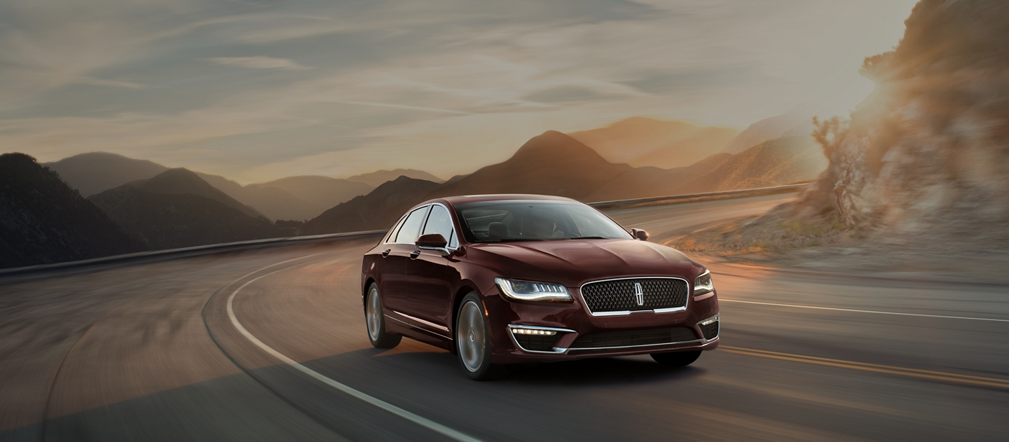 A 2020 Lincoln M K Z is shown being driven in the morning along a winding mountain road