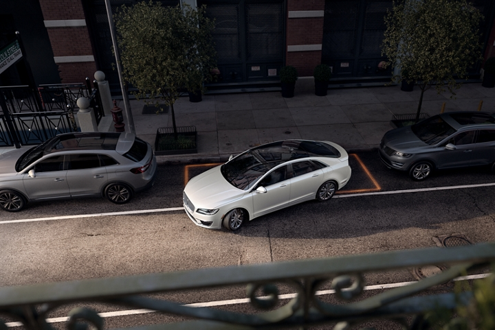 A 2020 Lincoln M K Z shown being parallel parked in a city setting